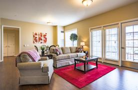 Appalachian floorplan living/dining area with spacious balcony overlooking courtyard or pond